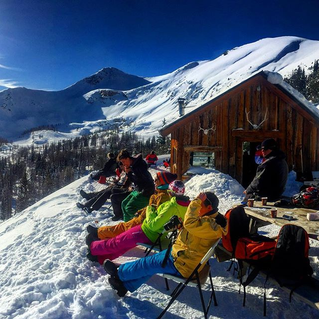 Soaking up the sun during lunch at Paradise Cabin today.  #snowmobiling #panoramabc #purecanada #tobycreekadventures #banff #canmore #canadianrockies #canada #canada150