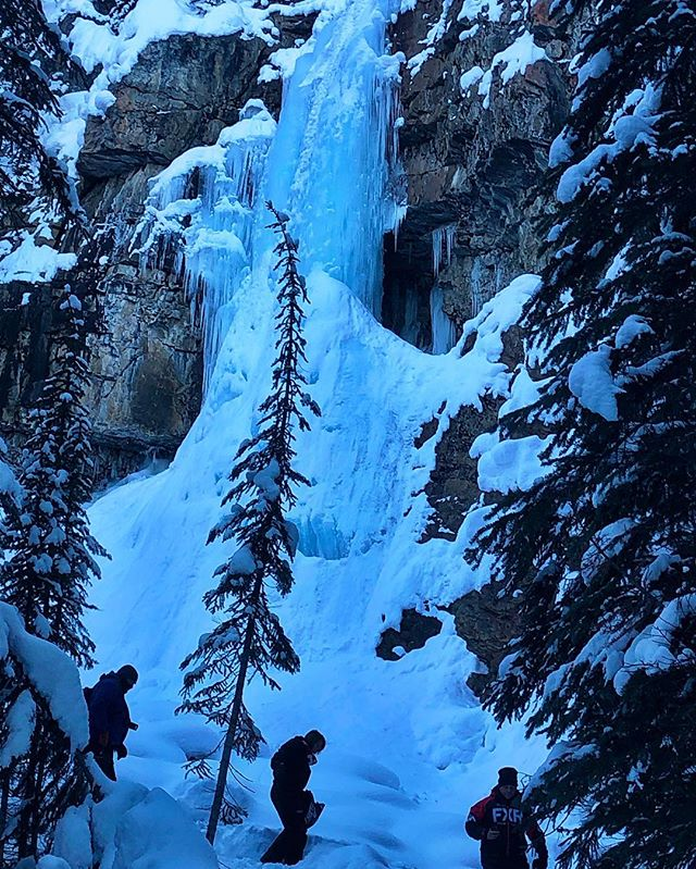 The Smith Falls towers over some of today's full-day guests who were checking the frozen waterfall out during a stop on the trail to Paradise.